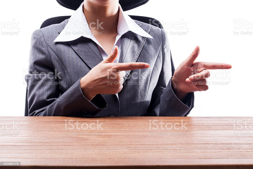 Businesswoman Pointing to the Side stock photo