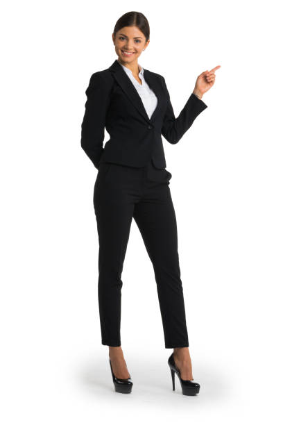 Businesswoman pointing with finger stock photo