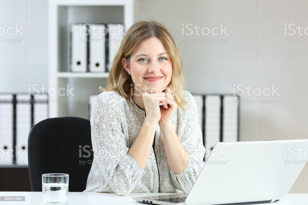 Businesswoman posing looking at you at office stock photo