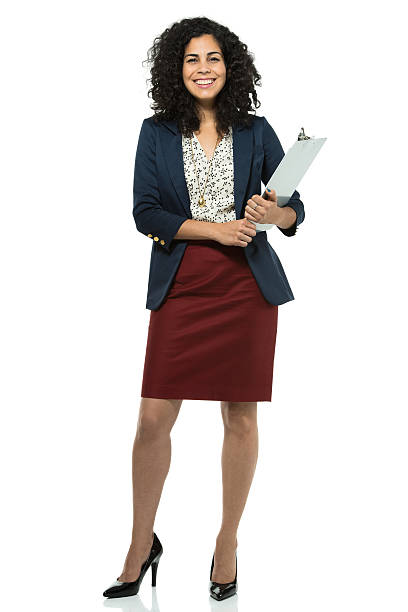 Businesswoman posing with a clipboard stock photo