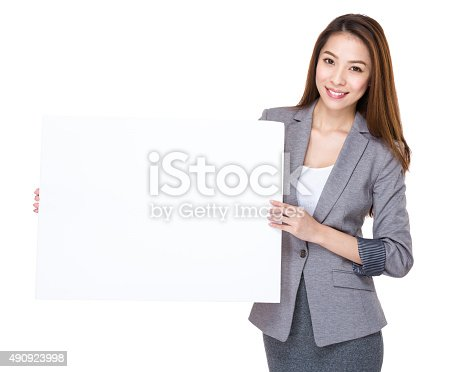 istock Businesswoman present with white board 490923998