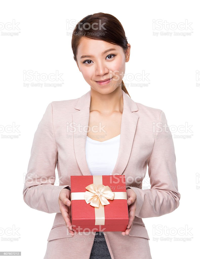 Businesswoman presenting a gift box stock photo