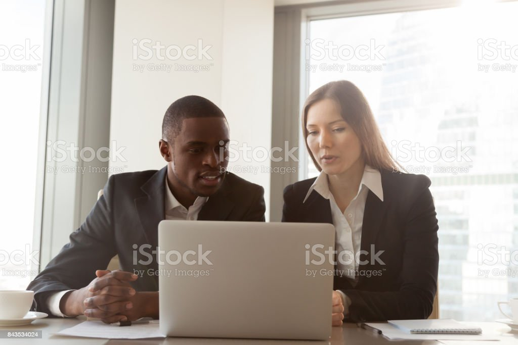 Businesswoman presenting new project to partner stock photo