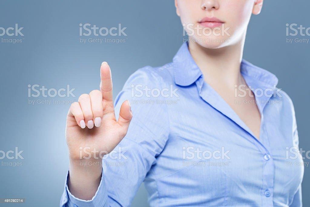 Businesswoman pressing a virtual button stock photo