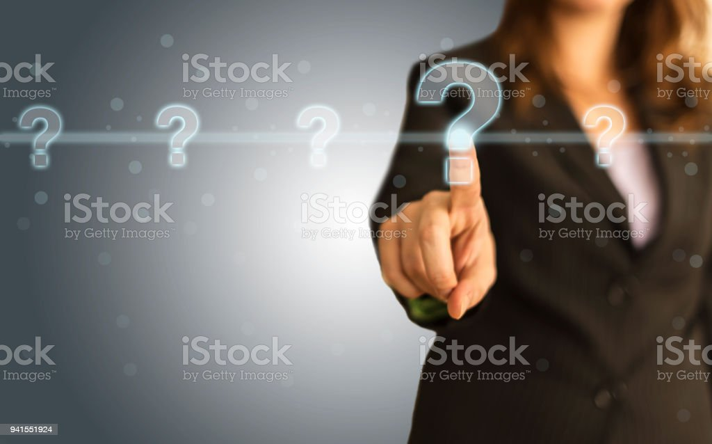 Businesswoman Pressing Question Mark stock photo