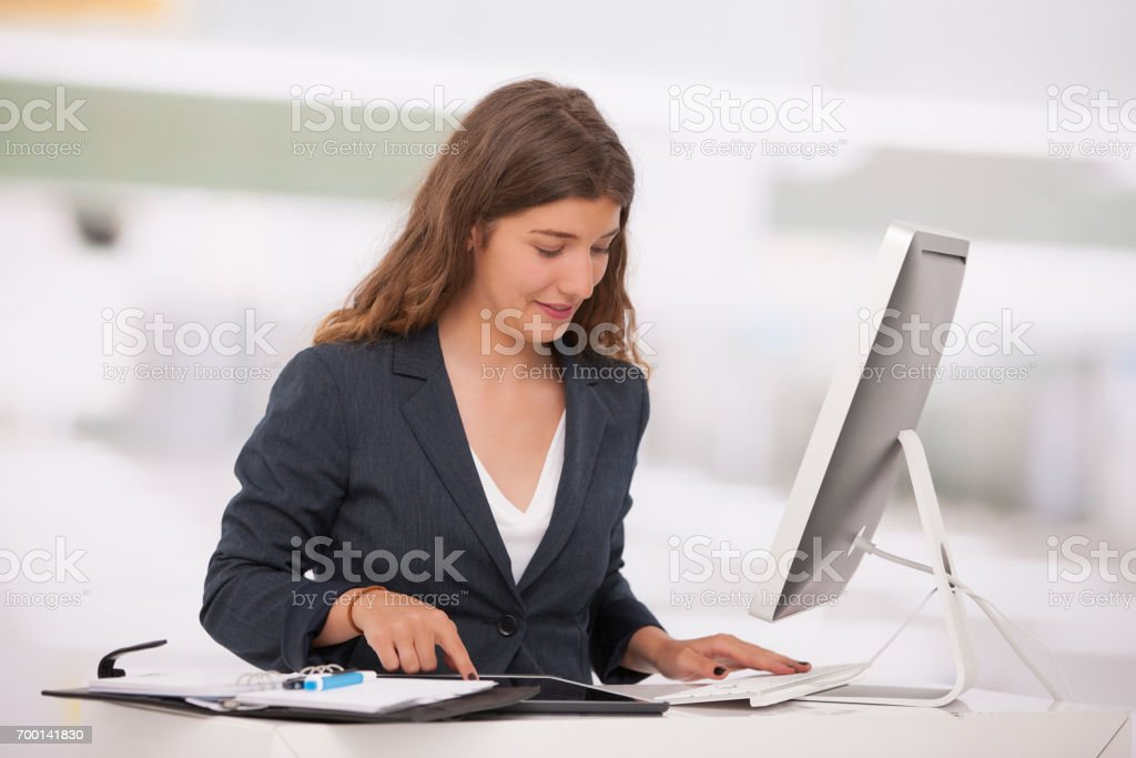 businesswoman proud to work in office stock photo