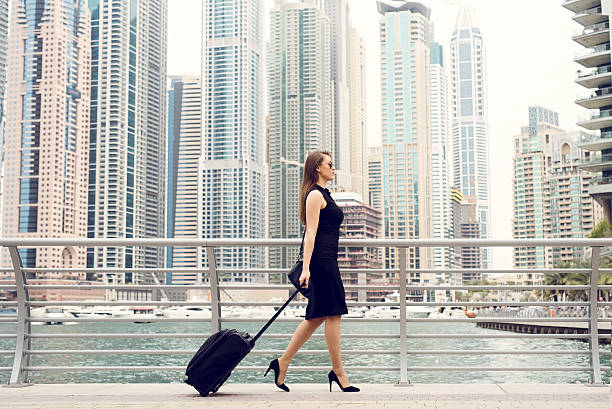 businesswoman pulling. - schwarze hohe schuhe stock-fotos und bilder