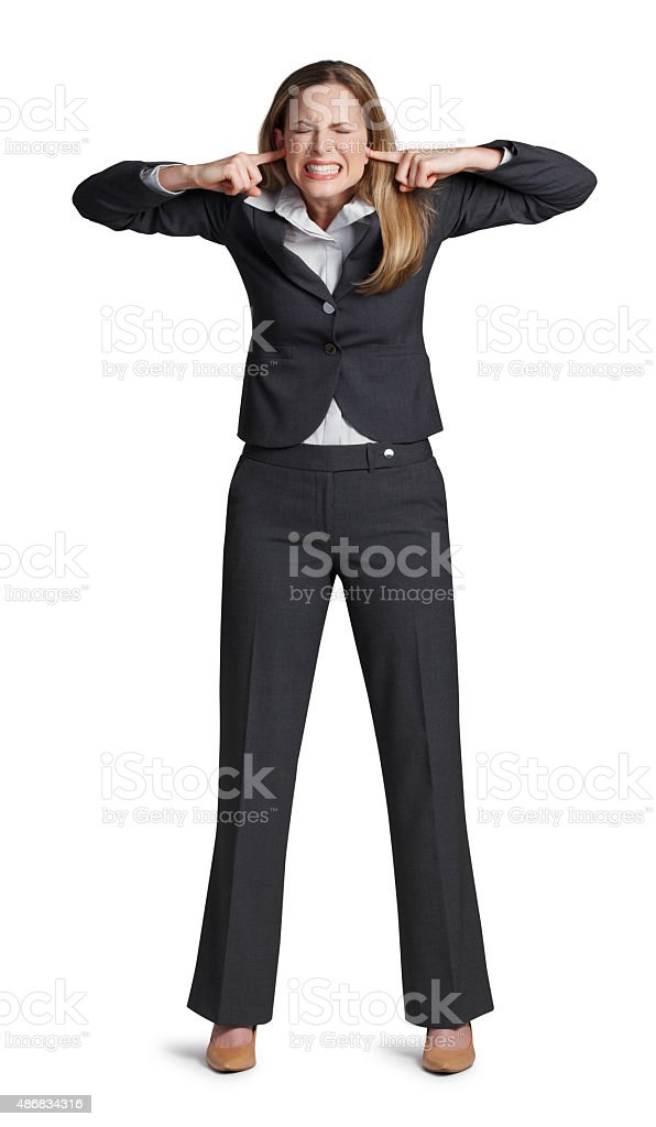 Businesswoman putting fingers in ears isolated on white background stock photo