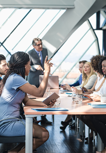 672116416 istock photo Businesswoman Raising Hand in The Middle of a Meeting 648878590