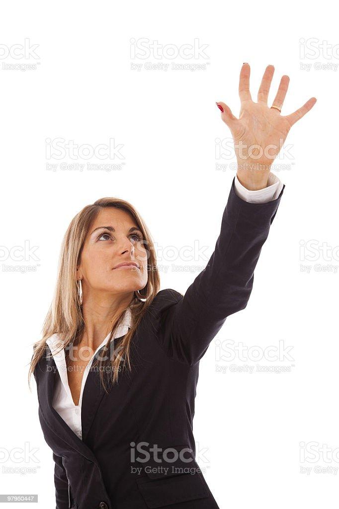 Businesswoman reaching something royalty-free stock photo