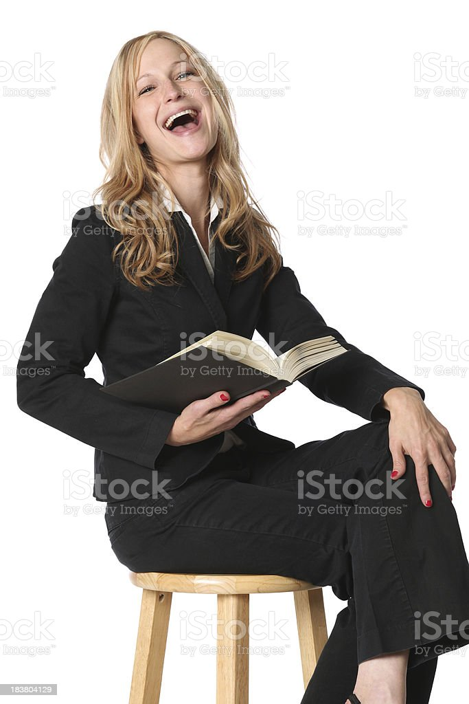 Businesswoman reading a book and laughing royalty-free stock photo