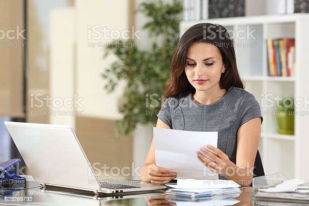 Businesswoman reading a letter at office picture id623269732?b=1&k=6&m=623269732&s=612x612&h=ynmtbgkkx1a6x8ulveed whuofwztgtc0di6kl x6ag=