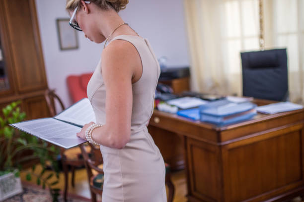Businesswoman reading documents stock photo