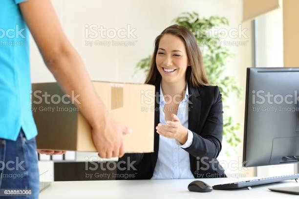 Businesswoman receiving a package picture id638883066?b=1&k=6&m=638883066&s=612x612&h=mbkhhe3uclikjtsbhpyurcignk6 gvia2dcf93rc1mw=