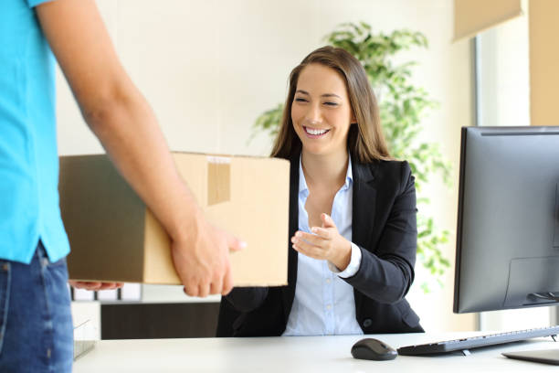 Businesswoman receiving a package stock photo