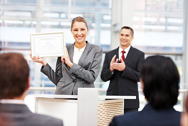 businesswoman receiving an award - certificate stock photos and pictures