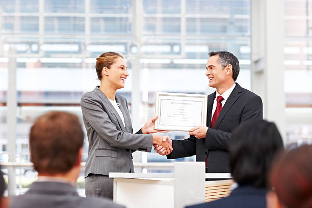Businesswoman Receiving an Award stock photo