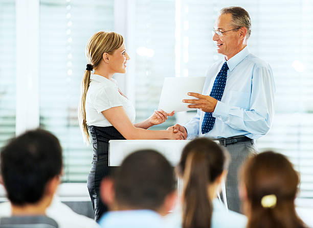 Businesswoman receiving an award. stock photo