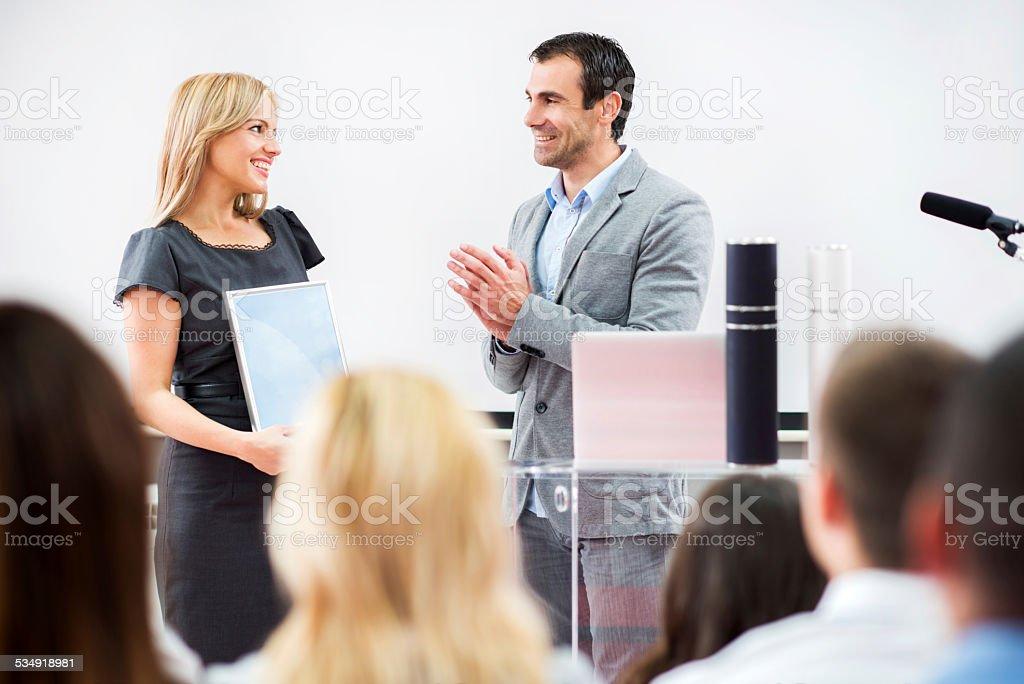 Businesswoman receiving an award. stock photo