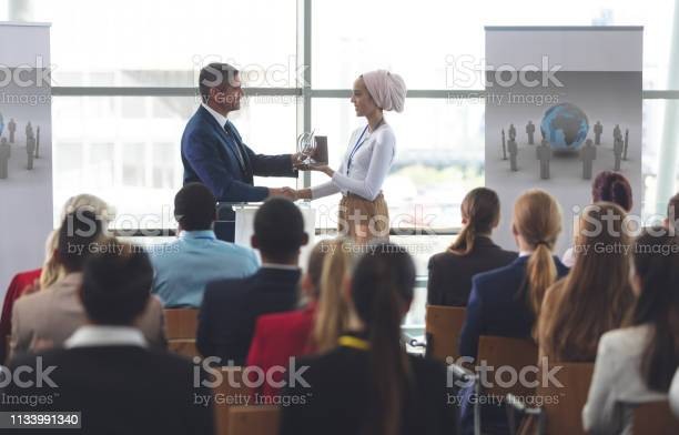 Businesswoman receiving award from businessman in a business seminar picture id1133991340?b=1&k=6&m=1133991340&s=612x612&h=qdfwz6tc9ufx5hankk0thqadvlqxs9 xqc pavylkho=