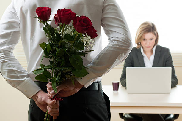 Businesswoman Receiving Red Roses stock photo