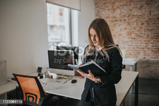 istock A businesswoman records business plans in the office. 1127084114