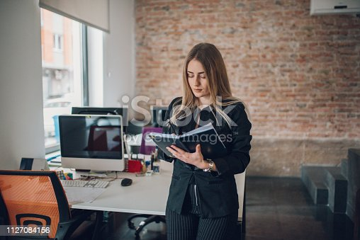 istock A businesswoman records business plans in the office. 1127084156