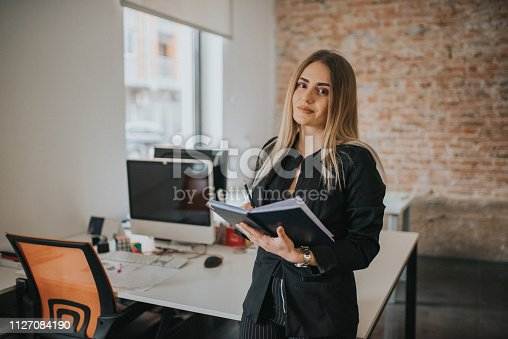 istock A businesswoman records business plans in the office. 1127084190