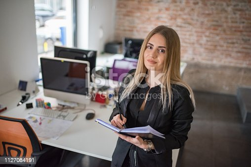 istock A businesswoman records business plans in the office. 1127084191