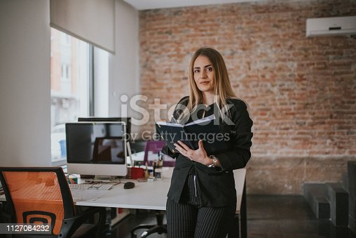 istock A businesswoman records business plans in the office. 1127084232