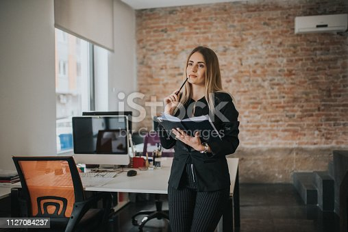 istock A businesswoman records business plans in the office. 1127084237