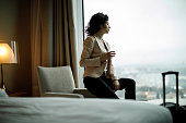 Businesswoman relaxing in a hotel room