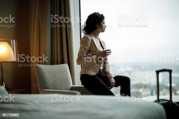 Businesswoman relaxing in a hotel room picture id951703682?b=1&k=6&m=951703682&s=612x612&h=ikzyqthiqlvfsyqikkx1saspvjr nn70btdbuqbtwky=