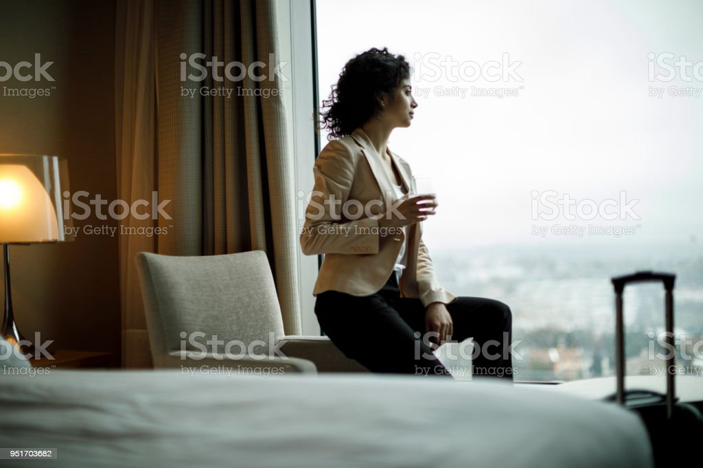 Businesswoman relaxing in a hotel room stock photo
