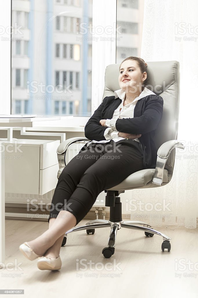 Businesswoman Relaxing In Leather Chair At Office Stock Photo Download Image Now Istock