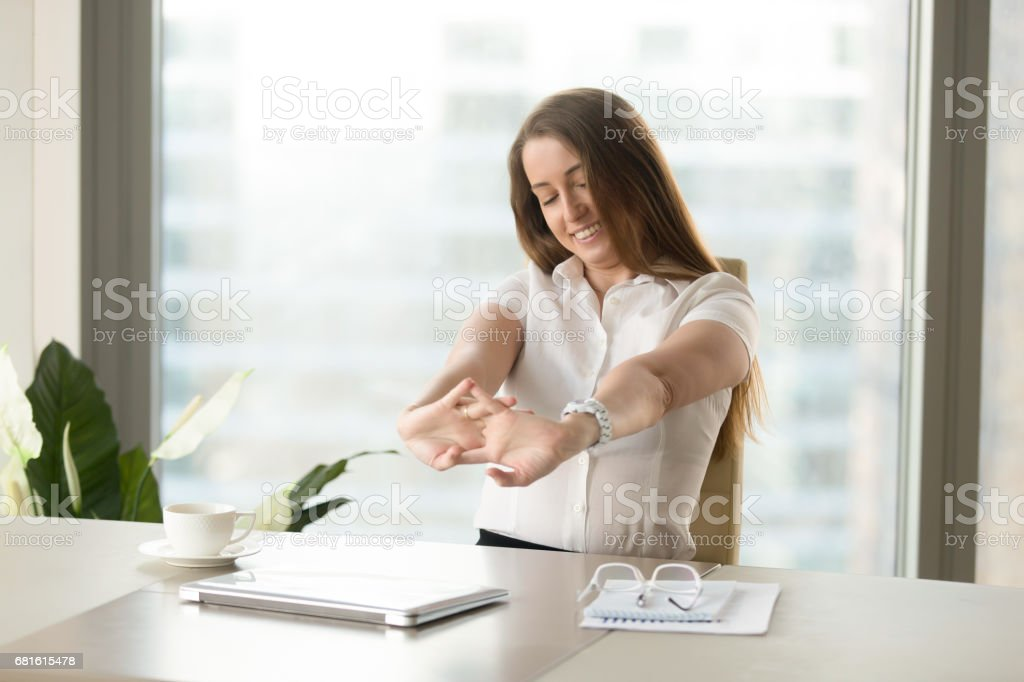 Businesswoman relaxing muscles after finishing job - Royalty-free 20-29 Years Stock Photo