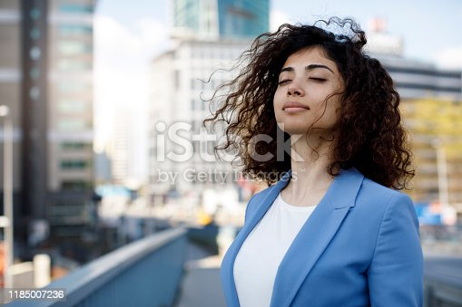 istock Businesswoman relaxing outdoor 1185007236