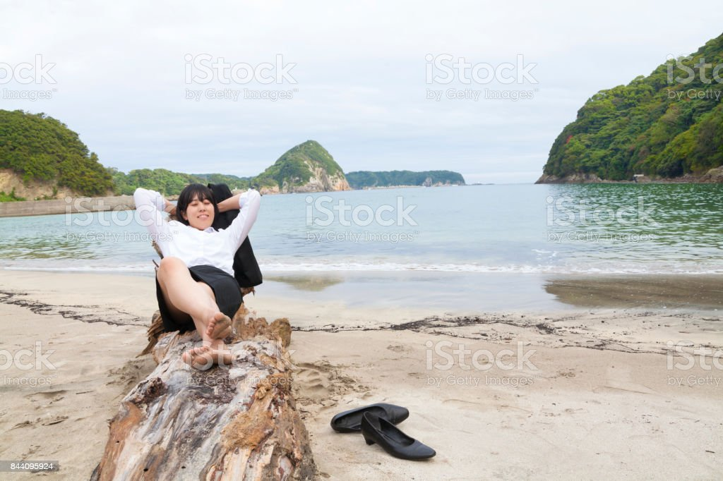 Businesswoman Resting At Beach стоковое фото
