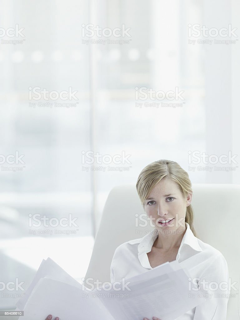 Businesswoman reviewing paperwork in office royalty-free stock photo