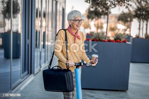 874772840istockphoto Businesswoman riding an electric scooter in the city 1167980186