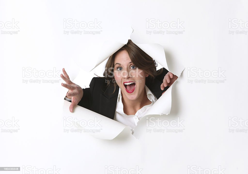 Businesswoman ripping through paper emergence royalty-free stock photo