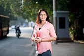 istock Businesswoman road side in city 1252291706