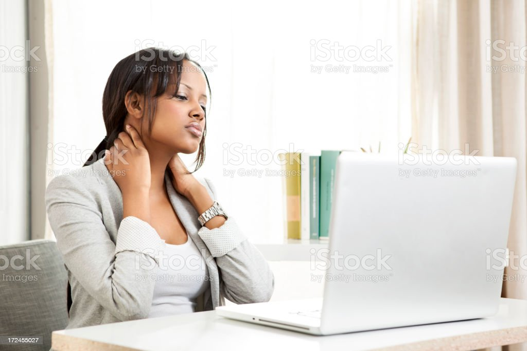 Businesswoman rubbing her neck royalty-free stock photo
