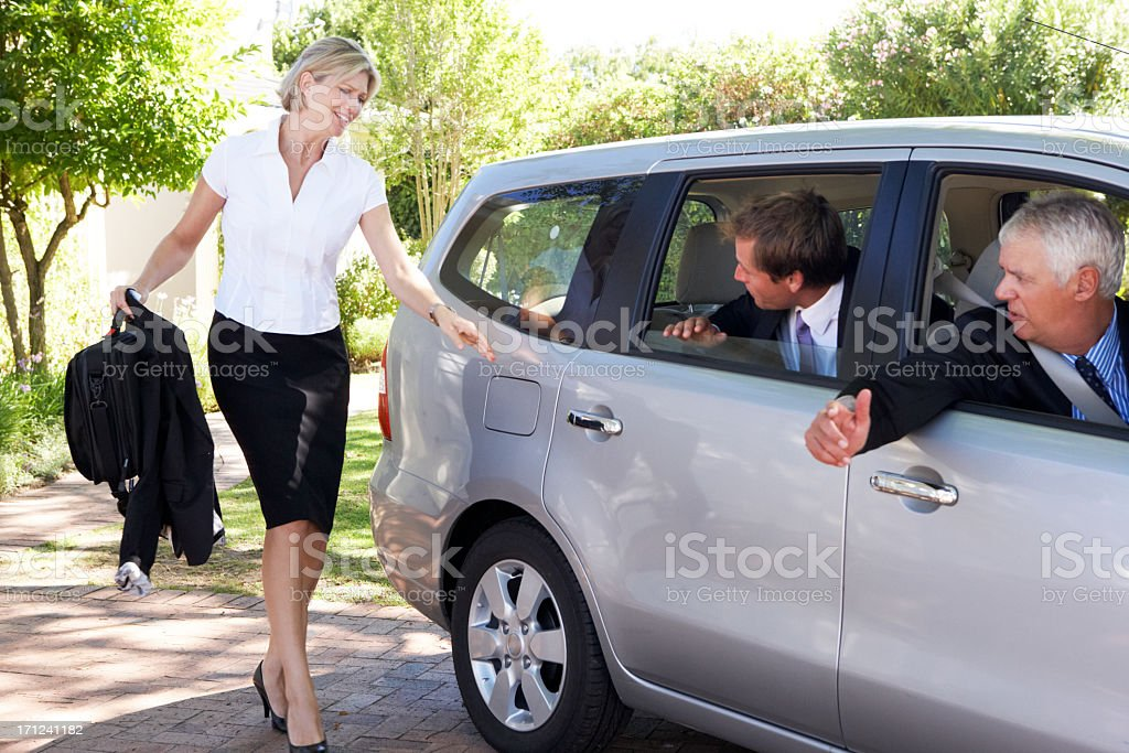 Businesswoman Running Late To Meet Colleagues Car Pooling Journe stock photo