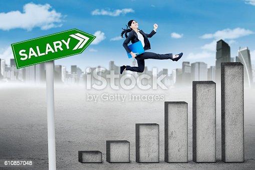 513121118istockphoto Businesswoman runs above salary chart 610857048