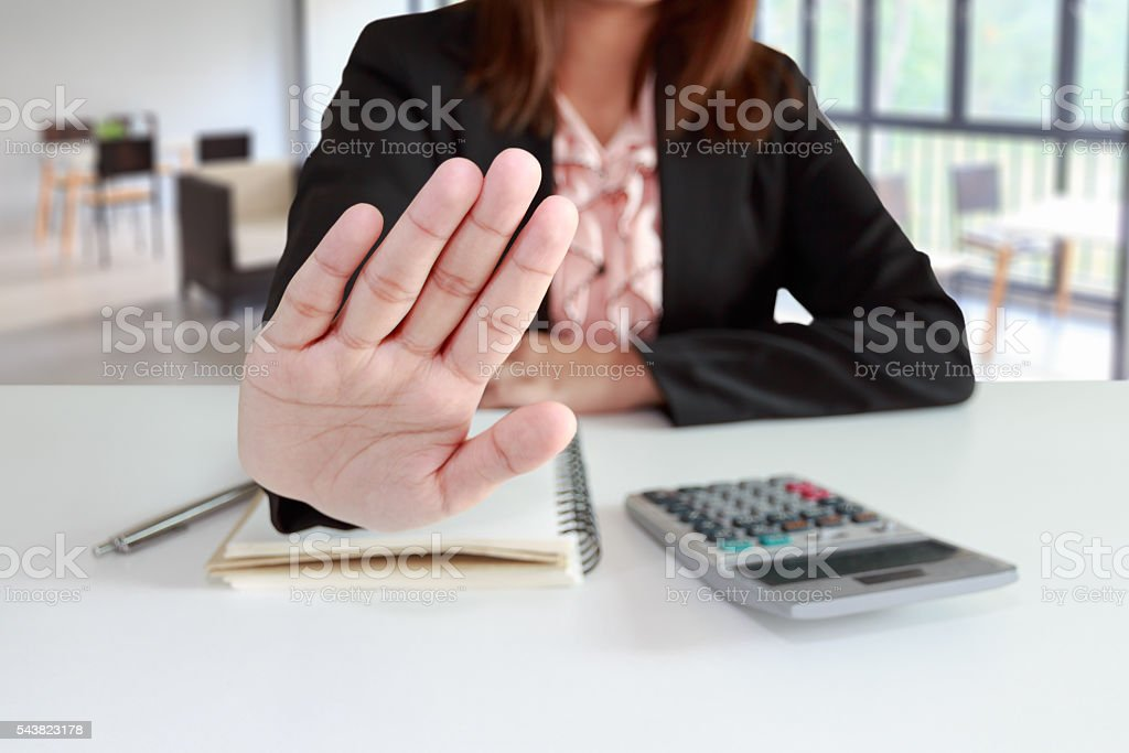 Businesswoman says no or hold on at her office stock photo