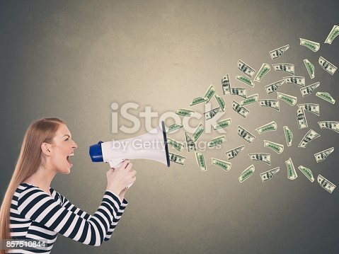 istock Businesswoman screaming into a megaphone 857510844
