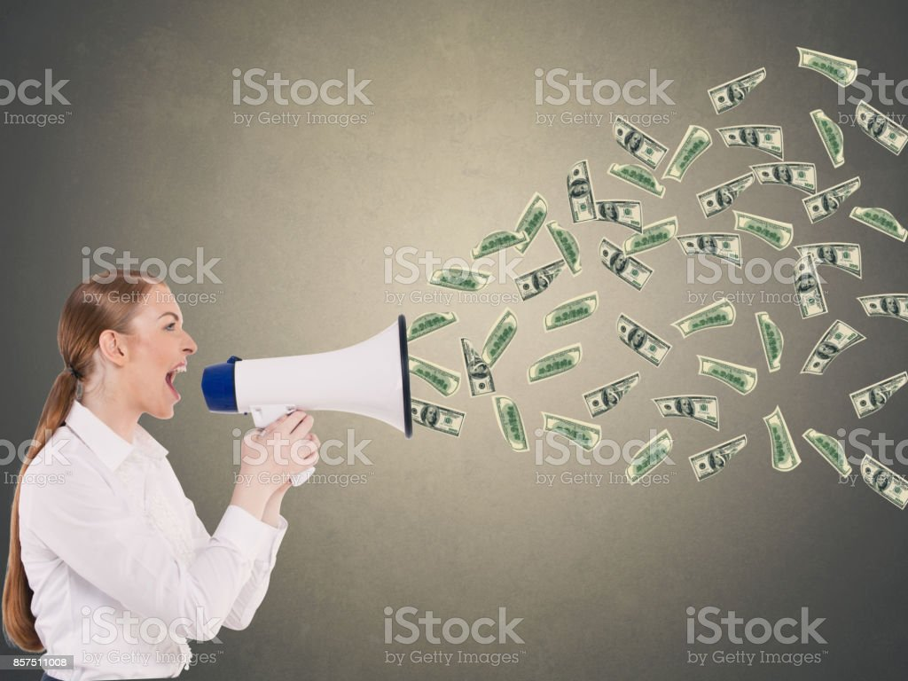 Businesswoman screaming into a megaphone stock photo