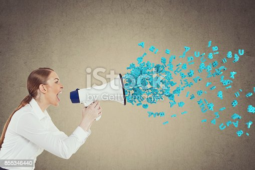 istock Businesswoman screaming into megaphone 855346440