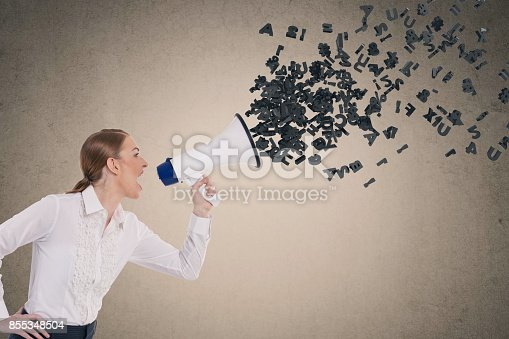 istock Businesswoman screaming into megaphone 855348504